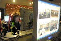 A chinese man plays online games at an internet cafe