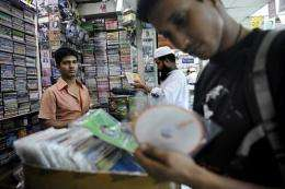 A shopper looks at counterfeit computer programmes in Dhaka