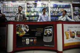 BlackBerry users eye alternatives as curbs loom (AP)