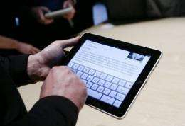 Guests play with the new Apple iPad
