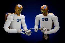 Robot's space debut 'giant leap for tinmankind' (AP)