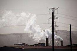 Smoke emitted from chimneys at a coal mine