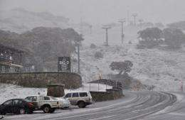 Snow and ice covering buildings and ski lifts at Mount Hotham, Victoria