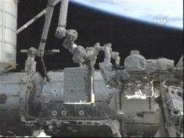 Astronauts take 1st spacewalk of shuttle mission (AP)