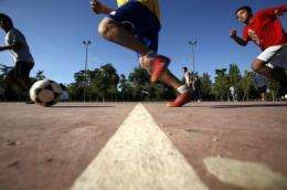 Physical activity reduces the effect of the obesity gene in adolescents