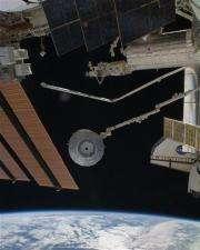 Spacewalking astronauts turn plumbers, hook hoses (AP)