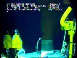 This still image from a live BP video feed shows oil gushing from a leaking BP oil well-pipe