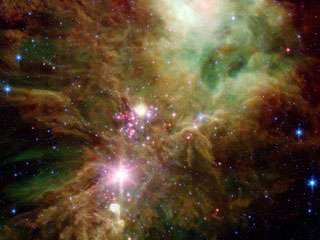 Spitzer Unveils Infant Stars in the Christmas Tree Cluster