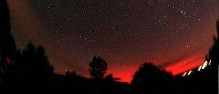 Ruby-colored Northern Lights over Payson, Arizona, on Sept. 11, 2005. Photo credit: Chris Schur