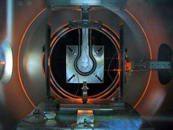 DS4G thruster firing during tests in the ESTEC Electric Propulsion facility