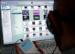 A man uses the iTunes Music Store to download music