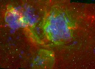 This false-color image shows infrared (red), optical (green), and X-ray (blue) views of the large star-forming complex N51