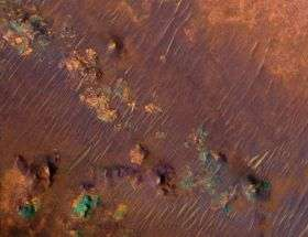 NASA Orbiter Provides Color Views of Mars Landing Site Candidates