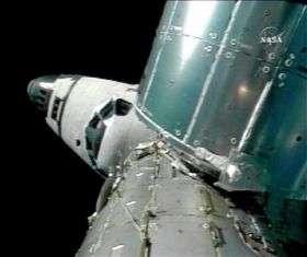 Spacewalk on Despite Robot Trouble (AP)