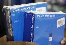 Adobe Systems posts 4Q loss, weighed by charges (AP)