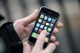 A man operates his Apple iPhone in Paris
