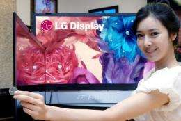 A promoter shows off  liquid crystal display (LCD) television panels in Seoul earlier this year