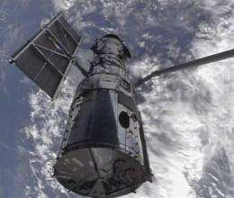 Astronauts grab Hubble, prepare for tough repairs (AP)