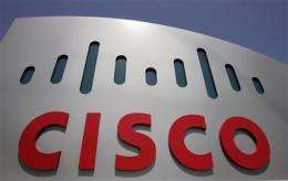 Cisco earnings fall 46 pct but upturn expected (AP)