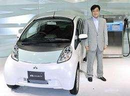 Mitsubishi Motors President Osamu Masuko introduces the company's first mass production electric vehicle