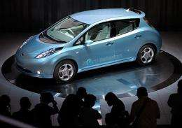 Photographers take pictures of the new Japanese Nissan Motor's electric vehicle called