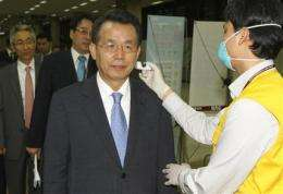 South Korea says American has swine flu (AP)