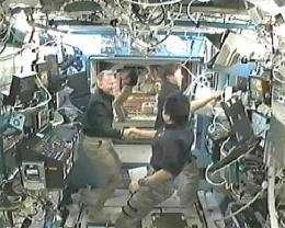 Spacewalk Day: Astronauts install new porch on lab (AP)