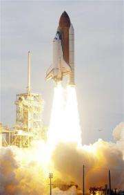 Space shuttle blasts off after month's delay (AP)