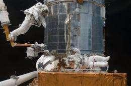 Astronauts take final spacewalk for Hubble repairs (AP)