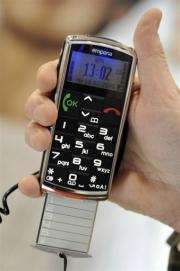 A man holds an Emporia Telecom phone for senior citizens at the Mobile World Congress (GSMA) in Barcelona