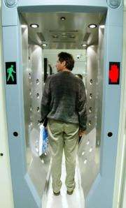 A man passes through a high-tech explosive-detection machine at John F. Kennedy airport in New York