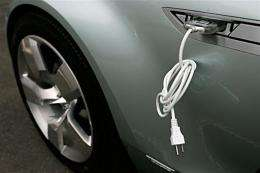 An electric cable is attached to the side of a car