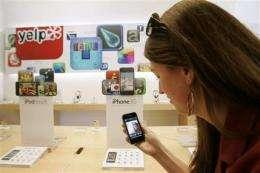 Apple 2Q profit gains 15 percent, beats Street (AP)
