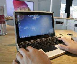 A visitor checks out Nokia's first notebook, the