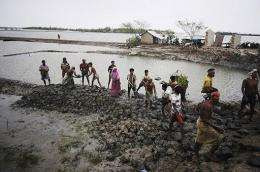 Bangladeshi villagers rebuild an embankment in Padmapukir on the outskirts of Satkhira