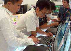 Consumers shop for laptop computers at a computer mart in Ningbo in eastern China's Zhejiang province