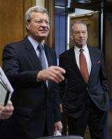 House eyes new taxes as senators pare health bill (AP)