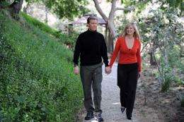 Kent Shocknek, CBS morning television news anchor, walks with his wife Karen in their garden created by Robert Cornell