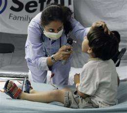 McTriage: Hospitals use drive-thrus for swine flu (AP)