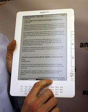 Members of the media are given a demonstration of the Kindle DX