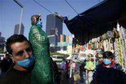 Mexicans put faith in masks _ but do they work? (AP)