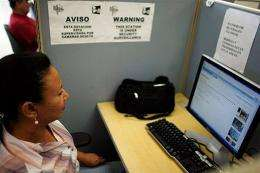 Nelly Dubon uses a computer to access her yahoo email account on March 6, 2009 in Miami, Florida