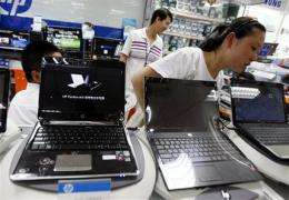PC makers race to comply with China's Web filter (AP)