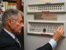 Scientist Leonard Kleinrock poses with the first Interface Message Processor
