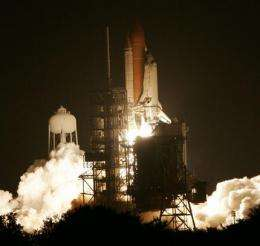 Shuttle steers closer to space station for hookup (AP)