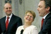 Swedish Prime Minister Fredrik Reinfeldt (L) and fellow coalition members Maud Olofsson (C) and Jan Bjorklund (R)