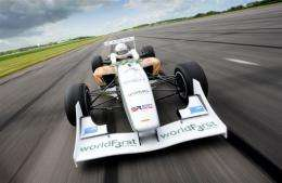 The WorldFirst Formula 3 racing car drives down the straight of a test track at Bruntingthorpe, near Lutterworth