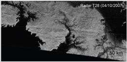 Global view of valleys on Titan shows north south contrast