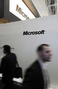 Visitors walk past the stand Microsoft at the world's biggest high-tech fair