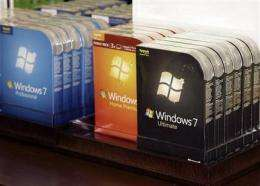 Windows plan lowers Microsoft profit but shares up (AP)